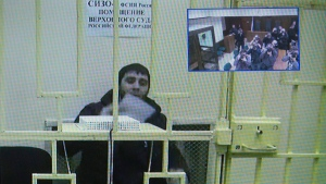 Zaur Dadaev speaks from his jail via a video link broadcast to the court in Moscow, Russia, on April 1, 2015. (AP / Ivan Sekretarev)