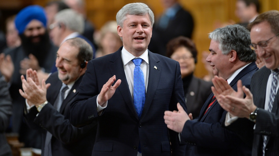 Prime Minister Stephen Harper is appaluded by Conservative MPs as he answers a question during Question Period in the House of Commons in Ottawa on Wednesday, April 1, 2015. (Adrian Wyld / THE CANADIAN PRESS)