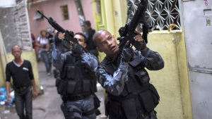 Military police officers patrol in the Roquette Pinto shantytown, part of the Mare slum complex in Rio de Janeiro, Brazil, Wednesday, April 1, 2015. (AP / Felipe Dana)