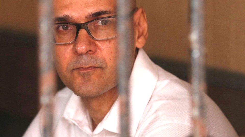 Canadian teacher Neil Bantleman sits in a holding cell prior at South Jakarta District Court in Jakarta, Indonesia, Tuesday, Dec. 2, 2014. (AP / Tatan Syuflana)