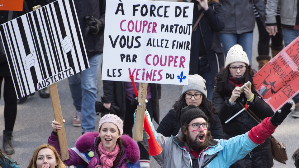 Students demonstrate against austerity measures and government cuts at a protest, in Montreal, Thursday, April 2, 2015. (Paul Chiasson / THE CANADIAN PRESS)