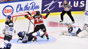 Canada's Natalie Spooner, centre, reacts after scoring a goal during the Women's Hockey World Championship semifinal match between Canada and Finland, in Malmo, Sweden, Friday, April 3, 2015. (AP / Claudio Bresciani)