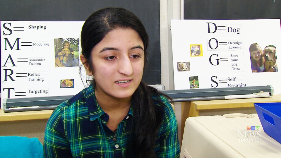 Grade 10 student Simar Vadwal speaks about the Canines in the Classroom program, in Caledon, Ont.