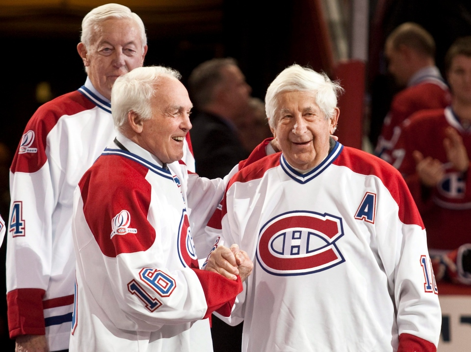 In this file photo, former Montreal Canadiens Henri Richard greets Elmer Lach, right as Jean Beliveau, rear, looks on during centennial celebrations Friday, December 4, 2009 in Montreal. (Paul Chiasson / THE CANADIAN PRESS)