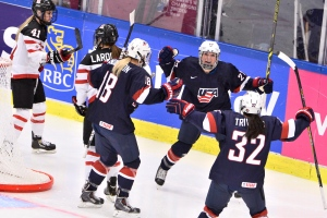 U.S. Anne Pankowski, centre facing camera, celebrates her goal with teammates Stephanie Andersson, centre (18) and Dana Trivigno, right, during the 2015 IIHF Ice Hockey Women's World Championship final between U.S. and Canada at Malmo Isstadion in Malmo, southern Sweden, on Saturday April 4, 2015. (AP / Claudio Bresciani)