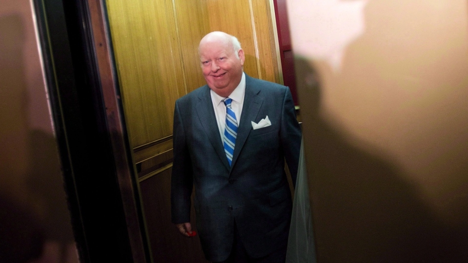 Mike Duffy takes the elevator as he arrives to the Senate on Parliament Hill in Ottawa on Oct. 28, 2013. (Sean Kilpatrick / THE CANADIAN PRESS)