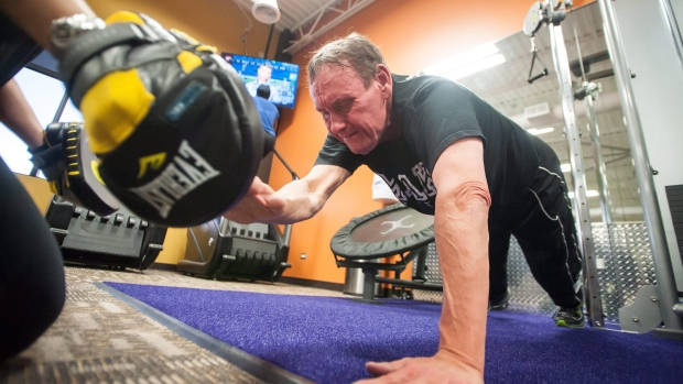 Mike Bonaventura of Crown Point has lost nearly 150 pounds over the past several years, by holding himself accountable and working with his personal trainer Maggie Keilman. (AP/ The Times, Danny Shelton)
