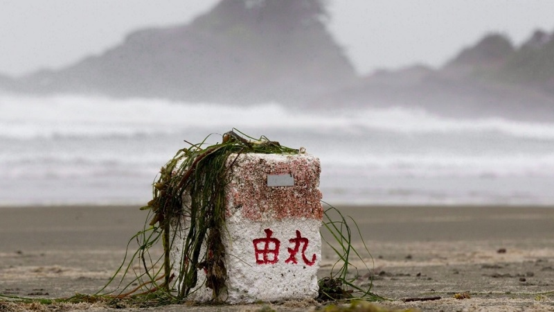 Ocean debris believed to be from Japan is posed for a photograph on Long Beach in Tofino, B.C. on April, 18, 2012. (Jonathan Hayward / THE CANADIAN PRESS)