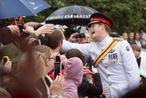 Prince Harry, right, meets well wishers after laying a wreath at the Tomb of the Unknown Soldier at the Australian War Memorial in Canberra, Australia Monday, April 6, 2015. (AP Photo/Andrew Taylor)