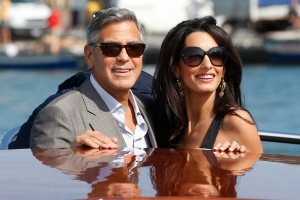 FILE - In this Sept. 26, 2014 file photo, George Clooney, left, and Amal Alamuddin arrive in Venice, Italy. Clooney, 53, and Alamuddin, 36, married in Venice, one of the world's most romantic settings. (Luca Bruno/AP Photo, File)