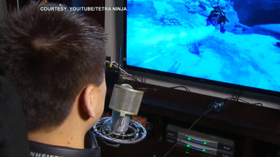 Nic Truong, a.k.a. 'Tetra Ninja,' plays a video game game at his home in Mississauga, Ont.
