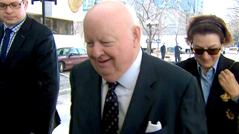 Suspended Sen. Mike Duffy makes his way to court in Ottawa, Tuesday, April 7, 2015.