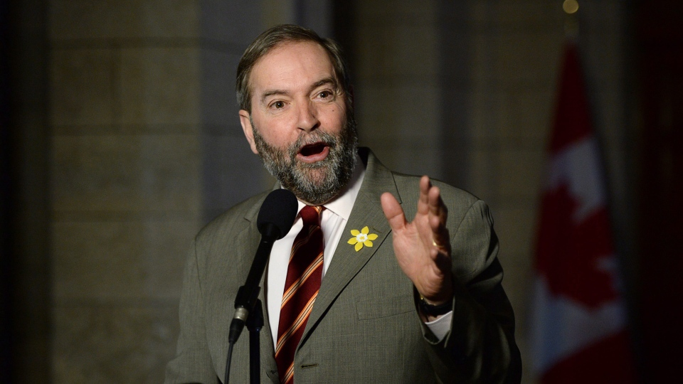 NDP Leader Tom Mulcair speaks to reporters following a caucus meeting on Parliament Hill in Ottawa on Wednesday, April 1, 2015. (THE CANADIAN PRESS/Sean Kilpatrick)