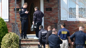 Authorities arrive at a home where the bodies of an elderly couple were found Monday, in Elmwood Park, N.J., April 6, 2015. (Northjersey.com/Tariq Zehawi)