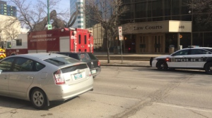 The haz-mat team and Winnipeg police respond at the Law Courts in Winnipeg on April 8, 2015.