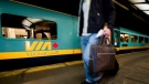 Passengers board the 5pm train to Toronto in Montreal, on July 26, 2009. (Peter McCabe / The Canadian Press)
