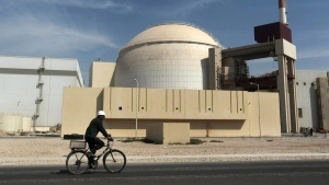 FILE - A worker rides past the Bushehr nuclear power plant in Iran, on Oct. 26, 2010. (AP Photo/Mehr News Agency, Majid Asgaripour)