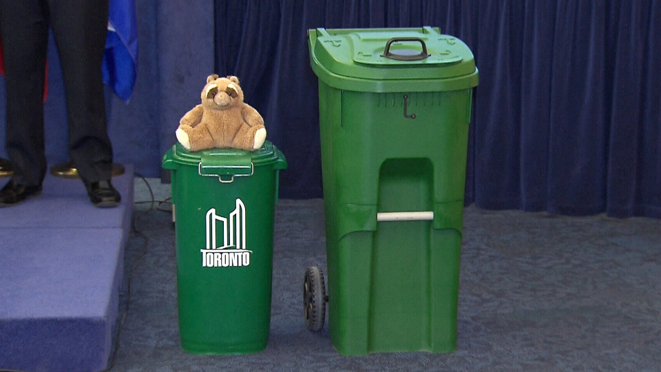 One of Toronto's new raccoon resistant green bins is shown next to an old one at Toronto City Hall on April 9, 2015.