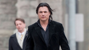 Suspended senator Patrick Brazeau returns to the courthouse in Ottawa following a break to attend the trial for suspended senator Mike Duffy as a member of the public on Thursday, April 9, 2015. (Justin Tang / THE CANADIAN PRESS)