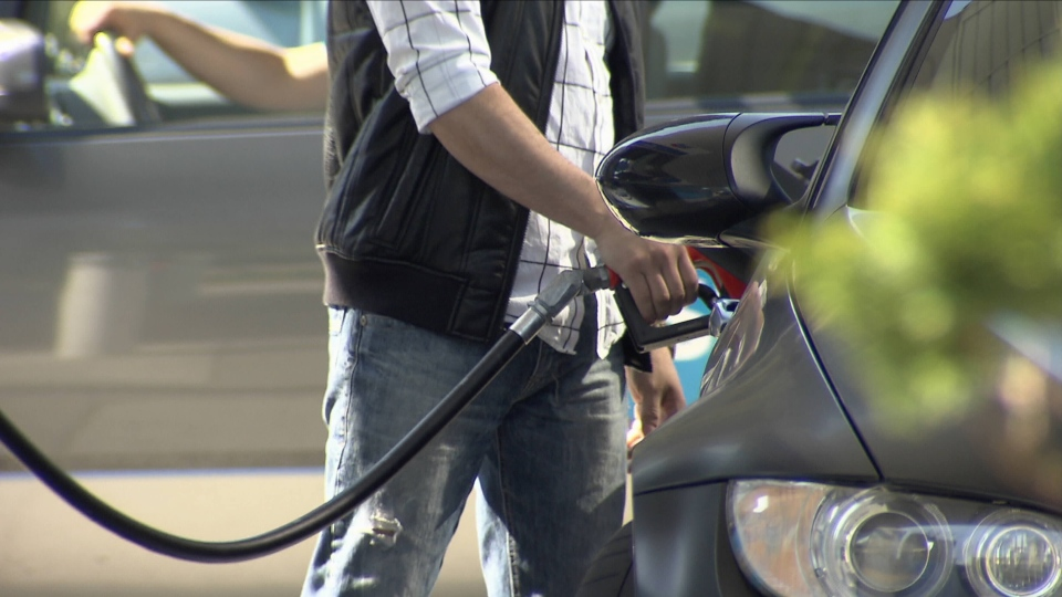 A driver fuels up his vehicle at a Vancouver gas station.