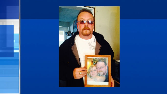 Michael Leblanc holds a picture of his wife, Deanna Leblanc. Leblanc died in 2014 at the Midland hospital after she was allegedly taken off life-support without authorization by a nurse. (Rob Cooper / CTV Barrie)
