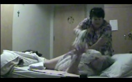 Footage captured by a hidden camera shows a care worker pushing and roughly handling home resident Hellen MacDonald.