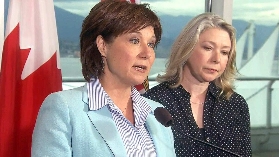 B.C. Premier Christy Clark comments on the fuel spill in English Bay, in Vancouver, Friday, April 10, 2015.