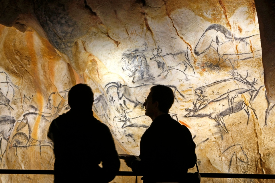 Visitors in the life size replica of Grotte Chauvet, or Chauvet cave, in Vallon Pont d'Arc, near Bollene, southern France, March 6, 2015. (AP / Claude Paris)