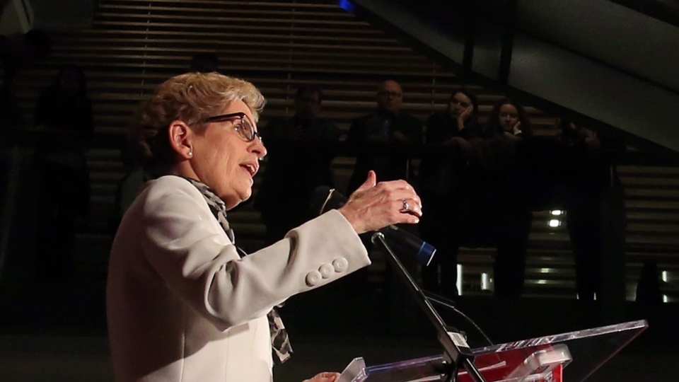 Ontario Premier Kathleen Wynne delivers a speech at a symposium on Women Politics at Ottawa Univesity in Ottawa, Thursday, March 5, 2015. (Fred Chartrand / THE CANADIAN PRESS)