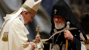 Pope Francis, left, is greeted by the head of Armenia's Orthodox Church Karekin II, during an Armenian-Rite Mass on the occasion of the commemoration of the 100th anniversary of the Armenian Genocide, in St. Peter's Basilica, at the Vatican, Sunday, April 12, 2015. (AP / Gregorio Borgia)