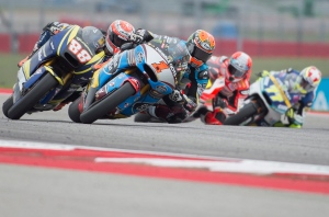 Tito Rabat (1), of Spain, leads Ricard Cardus (88), of Spain, and others out of turn nine during Moto2 qualifying for the MotoGP Grand Prix of the Americas motorcycle race at the Circuit of the Americas in Austin, Texas. Saturday, April 11, 2015. (AP / Darren Abate)