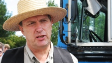 Farmer Michael Schmidt talks to reporters on outside court in Newmarket, Ont., Thursday, July 31, 2008. (Colin Perkel / THE CANADIAN PRESS)