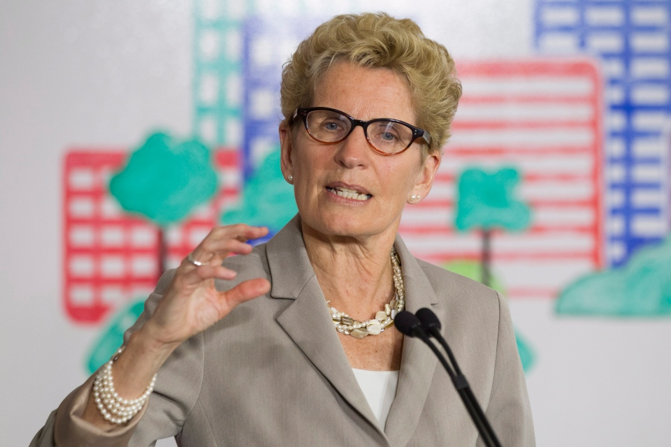 Ontario Premier Kathleen Wynne addresses the media during an announcement which outlined a cap and trade deal with Quebec aimed at curbing green house emissions, in Toronto, Monday, April 13, 2015. (Chris Young / THE CANADIAN PRESS)