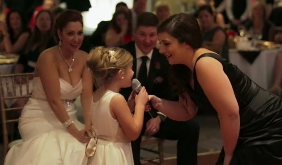 Seven-year-old Emma Coleman sings 'Love is an Open Door' with her mother is this image taken from YouTube video provided by Mitchell Reilly Productions.