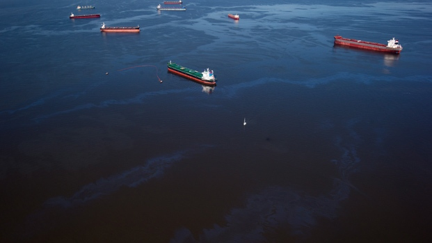 Bunker fuel drifts on the surface of Burrard Inlet after leaking from the bulk carrier cargo ship Marathassa, not seen, in Vancouver on Thursday, April 9, 2015. (Darryl Dyck / THE CANADIAN PRESS)