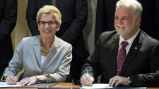 Wynne and Couillard sign environment agreement
