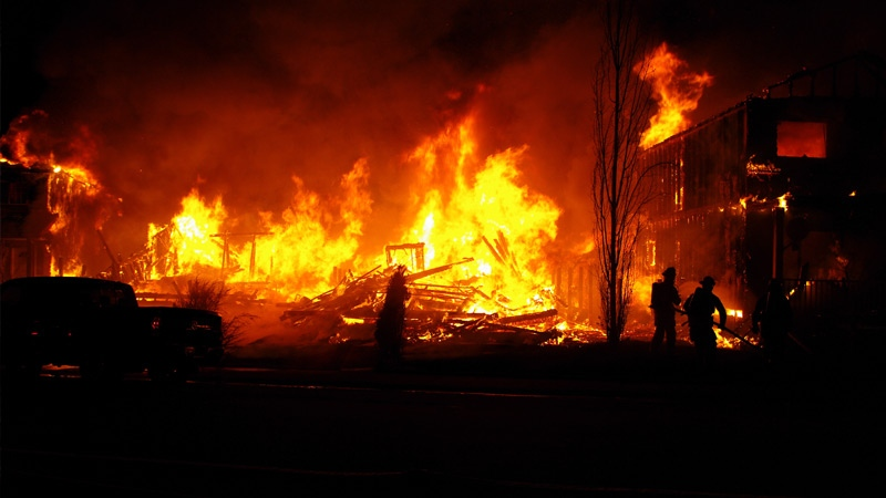 Emergency crews on the scene of a fire that destroyed four homes in Fort McMurray early Monday, April 13. Supplied.