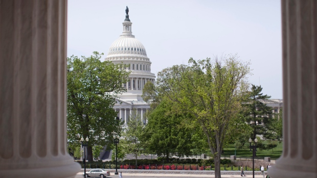 In this May 5, 2014, file photo, the Capitol building is seen through the columns on the steps of the Supreme Court in Washington. (AP / Carolyn Kaster)