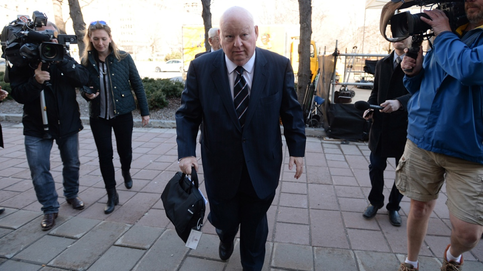 Suspended senator Mike Duffy arrives at the courthouse in Ottawa on April 14, 2015. (THE CANADIAN PRESS / Sean Kilpatrick)