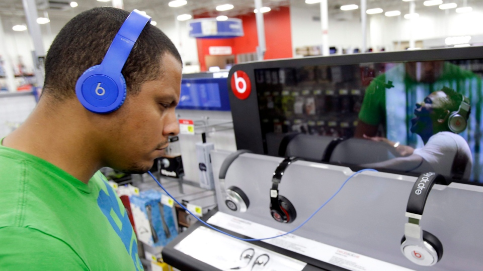 In this May 28, 2014 file photo, Eric Soriano listens to music in Orlando, Fla. (AP Photo/John Raoux)