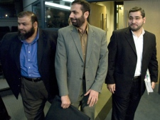Abdullah Almalki (right), Muayyed Nureddin and Ahmad El Maati arrive at a news conference in Ottawa Tuesday Oct.21, 2008. (Adrian Wyld / THE CANADIAN PRESS)
