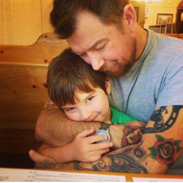 Justin Griner is shown with his son Sam, 8, in this photo posted to Facebook on April 12, 2015. (Laney Robertson Griner / Facebook)