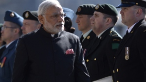 Indian Prime Minister Narendra Modi inspects the honour guard as he arrives on Parliament Hill in Ottawa on Wednesday, April 15, 2015. (Adrian Wyld / THE CANADIAN PRESS/)