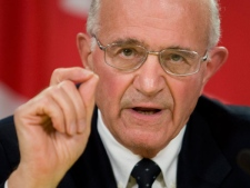 Retired Supreme Court justice Frank Iacobucci makes a point following the release of the Internal Inquiry Report into the Actions of Canadian Officials in Ottawa Tuesday Oct.21, 2008. (Adrian Wyld / THE CANADIAN PRESS)