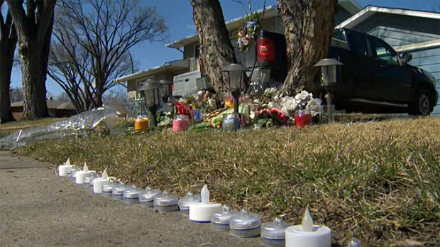 The memorial outside the home on Butler Crescent NW continues to grow as Calgarians pay tribute to the young people who were murdered there last year.