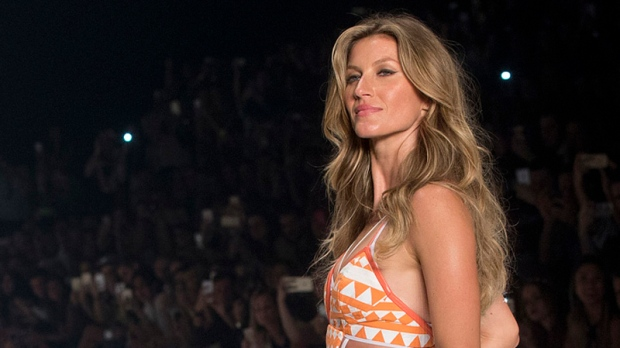 Brazilian supermodel Gisele Bundchen, who has been lighting up catwalks around the world for the past 20 years, is retiring from the runway. The 34-year-old mother of two has said her appearance at the 2015 Sao Paulo Fashion Week will be the last catwalk of her career.<br><br>Brazilian supermodel Gisele Bundchen wears a creation from the Colcci Summer collection at Sao Paulo Fashion Week in Sao Paulo, Brazil, Wednesday, April 15, 2015. (AP / Andre Penner)