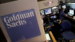 In this March 15, 2012 file photo, a trader works in the Goldman Sachs booth on the floor of the New York Stock Exchange. (Richard Drew/AP)