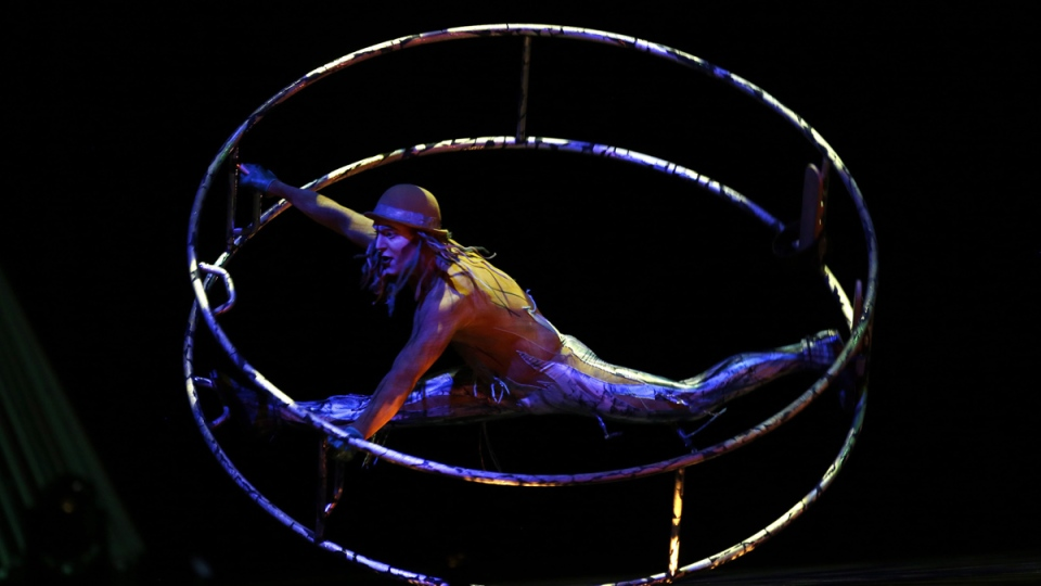 An artist of the Cirque du Soleil performs on the stage during the show 'Quidam' at the Meo Arena pavilion in Lisbon, Portugal, Thursday, Dec. 18, 2014. (AP / Francisco Seco)