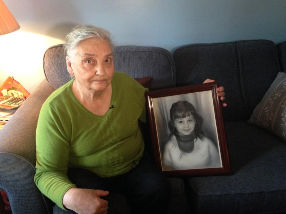 Paula Topic holds a photo of her daughter, Ljubica, who was abducted and killed in May 1971, in Windsor, Ont. on Wednesday, April 15, 2015. (Christie Bezaire / CTV Windsor)