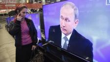 Russian President Vladimir Putin appeares on TV